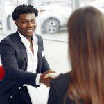 A Happy Guest at a Car Dealership